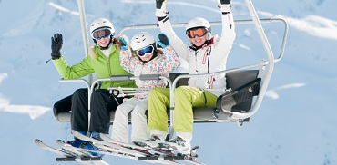 Skiers on ski lift in winter